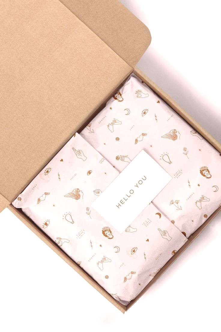 Cute branded packaging and custom tissue paper with branding pattern.
